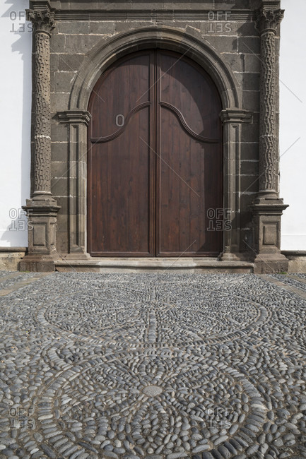 Portal with floor mosaic made of natural stones at the church Iglesia Nuestra Senora de Los Remedios, Buenavista del Norte, Tenerife, Canary Islands, Spain