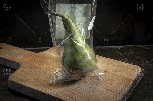 Pear packed in non-biodegradable plastics