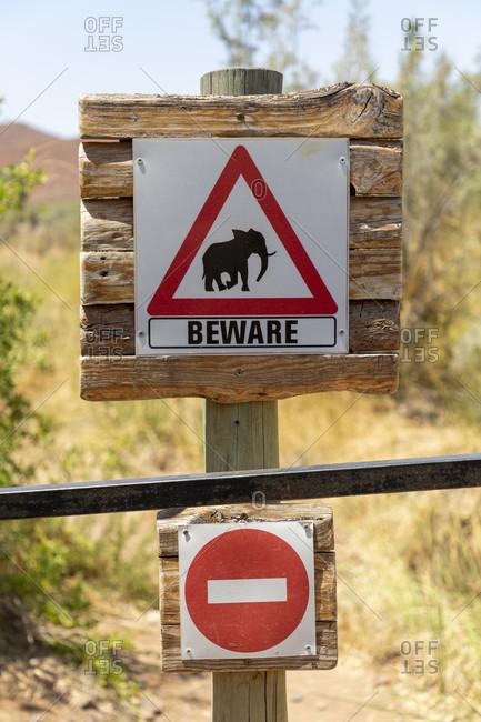 October 21, 2019: Warning sign in front of elephants, Damaraland, Namibia