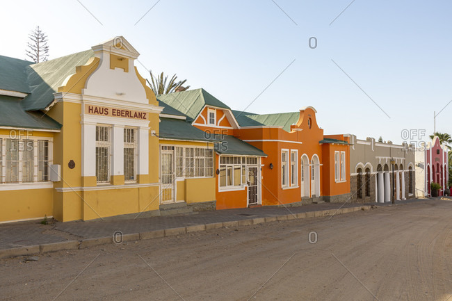 October 12, 2019: Several colorful historical buildings stand side by side on Berg Street, Luderitz