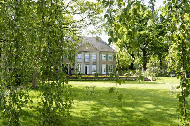 May 15, 2020: Berlin, Wannsee, Liebermann Villa, sunny garden, birch leaves