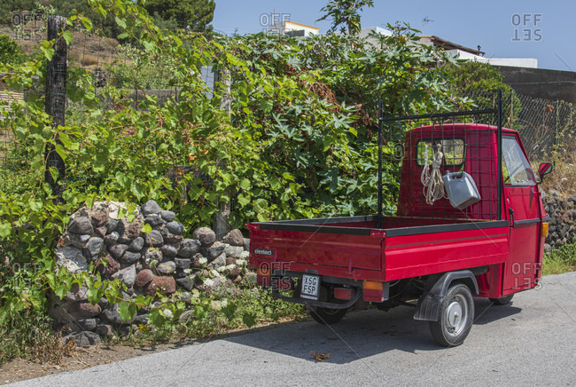 July 20, 2018: Sicily - Sunny impressions of the Aeolian Islands, red ape on the roadside on the island of Salina.