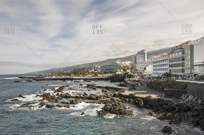 January 27, 2020: San Telmo beach, in the back bathing area Playa de Martianez by Cesar Manrique and hotels, Puerto de la Cruz, Tenerife, Canary Islands, Spain