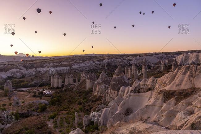 Hot air balloon in the morning in the eroded landscape near Goreme, Cappadocia, Anatolia, Turkey