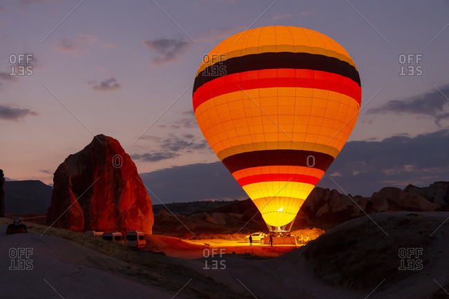 Hot air balloon in the morning in the eroded landscape near Goreme, Cappadocia, Anatolia, Turkey