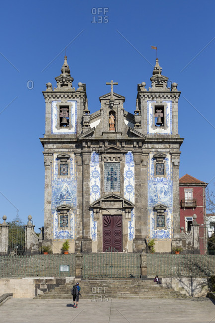 February 14, 2019: Igreja de Santo Ildefonso, baroque style church with tiled facade, Porto