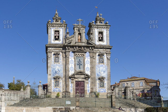 February 14, 2019: Igreja de Santo Ildefonso, baroque style church with tiled facade, Porto