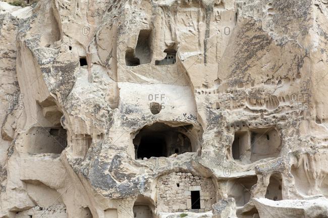 Cave architecture carved out of soft tuff near Goreme, Cappadocia, Anatolia, Turkey