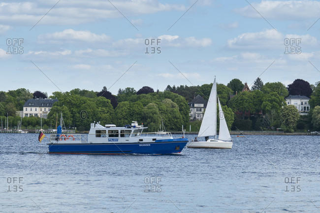 Berlin, Wannsee, police boat and sailing boat