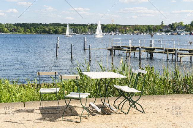 Berlin, Wannsee, Liebermann Villa, garden, riverside path with table and chairs, lake view