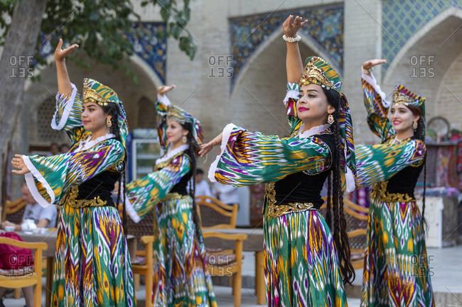 August 24, 2019: Folklore show, dance performance in the pilgrimage hostel Nodir Devonbegi, Bukhara, Uzbekistan