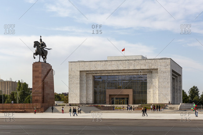August 17, 2019: Mana's equestrian statue and National Museum on the north side of Alatoo Square, Bishkek, Kyrgyzstan