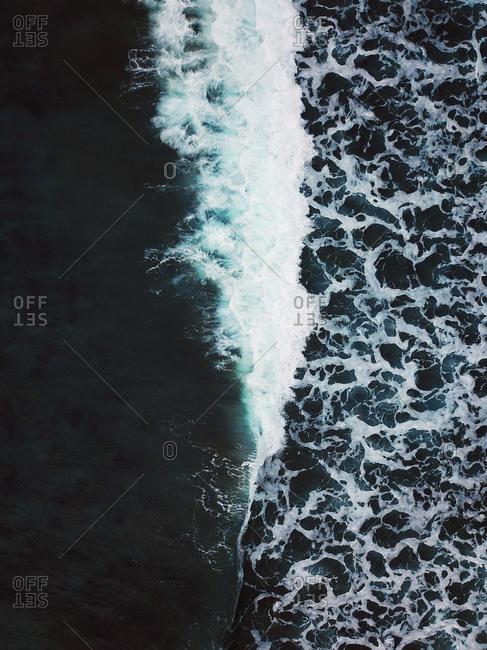 Aerial view of waves crashing in the Atlantic ocean at Saksun beach, Streymoy, Faroe Islands, Denmark.