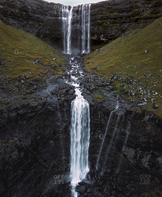 Aerial view of famous double waterfall Fossa in foggy mountains on Streymoy in Faroe Islands, Denmark.