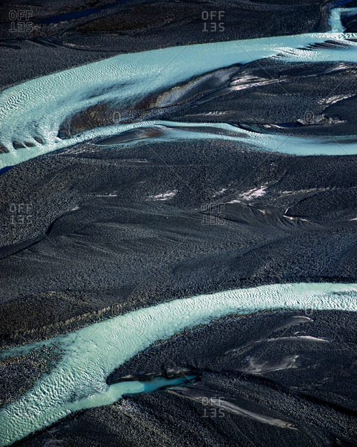 Aerial view of blue glacial rivers and textures melting from Tasman Lake and running into Lake Pukaki, Mount Cook National Park, South Island, New Zealand