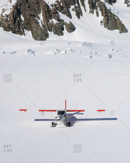 Aerial view of ski plane landing on snowy Tasman glacier in Mount Cook National Park, South Island, New Zealand