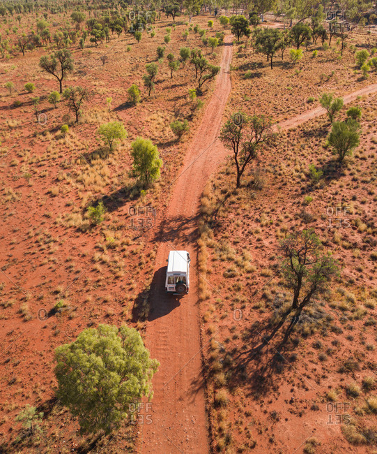 Aerial view of 4x4 truck on off road red dirt track in the outback desert in the Northern Territory, Australia