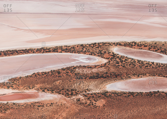 Aerial view of abstract minimal pink salt lake textures and outback orange colors on Lake Lefroy, Western Australia