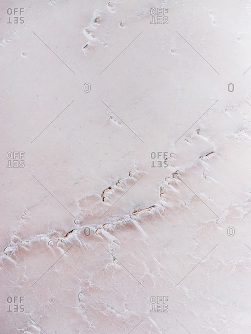 Aerial view of abstract minimal pink salt lake textures and pastel colors on Lake Lefroy, Western Australia