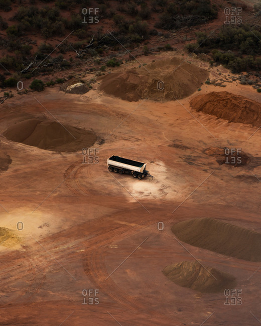 Aerial view of industrial mining operations and machinery with salt lake textures on Lake Lefroy, Western Australia