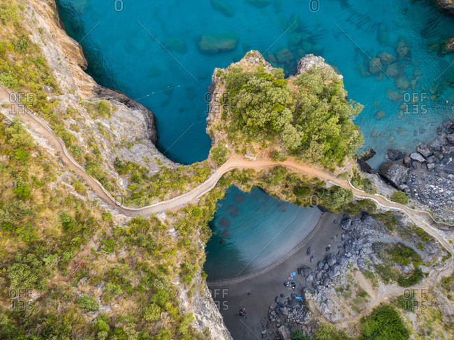 Aerial View of Arcomagno beach, an aerial sea view of a little rock beach, Calabria, Italy.