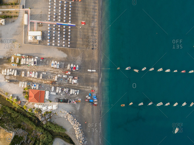 Aerial vertical view of anchored boats near seashore of Scalea, Calabria, Italy.