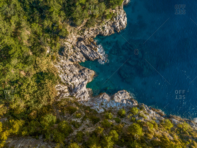 Aerial view of a corner of sea in the rocks of amalfi coast in the province of Salerno, Campania, Italy.