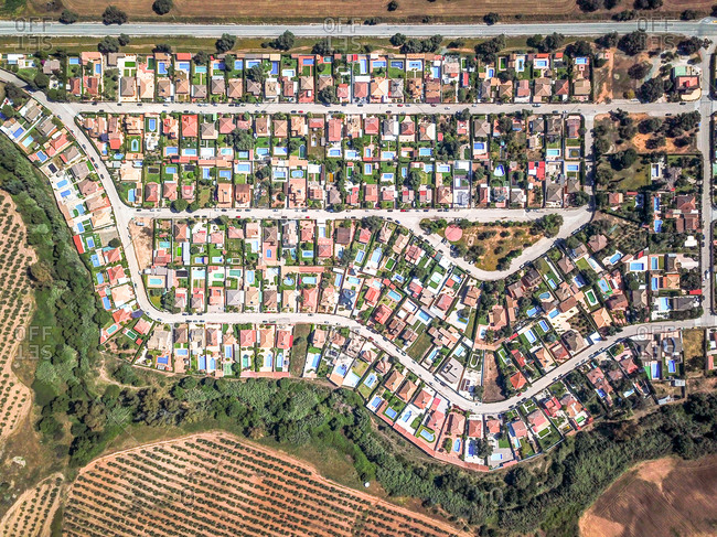 Aerial view of villas with pools in an urbanization in the middle of the countryside of Moron de la Frontera, Andaluisa, Spain.