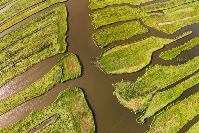 Abstract aerial view of islands with grassland and canals in peat meadow nature reserve Wormer- en Jisperveld, Noord-Holland, The Netherlands