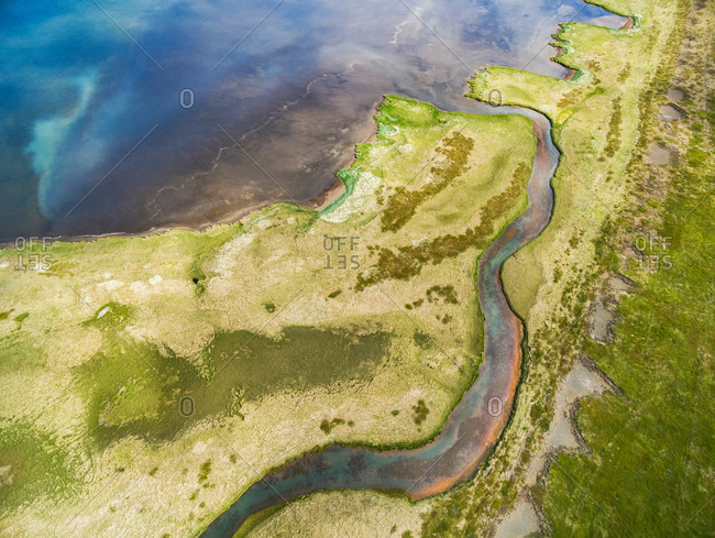 Abstract aerial view of small stream at the edge of a lagoon, Vatsnes, northern Iceland