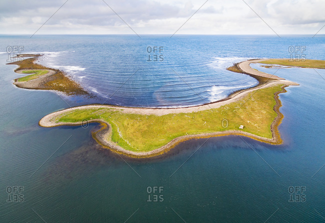 Aerial view of a peninsula in the sea just behind the coast, Melrakkasletta, northern Iceland