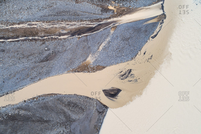 Abstract aerial view of two rivers with different sediment colors flowing together, Jarlhettukvisl, highlands of Iceland