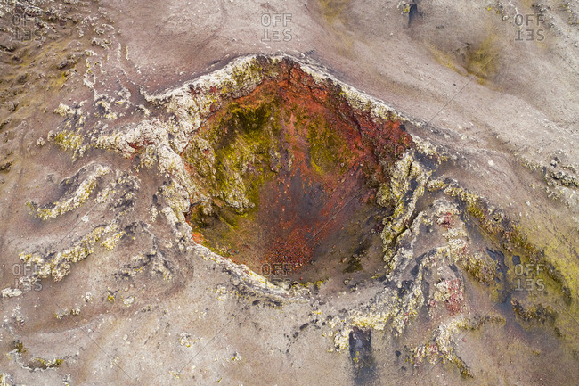 Aerial view of a colorful crater on a northern mountainside of Hekla volcano, highlands of Iceland