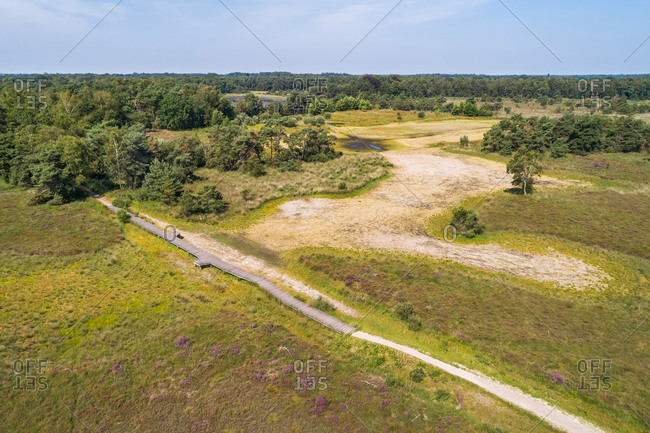 Aerial view of path and decking bridge over completely dried out lake during a dry summer, Steenhaarplassen, Buurserzand, Twente, Overijssel, Netherlands