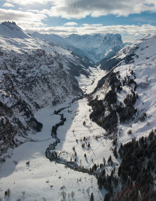 Aerial View of Snowy Mountains and Snow Covered Valley in the Bernese Alps, Switzerland