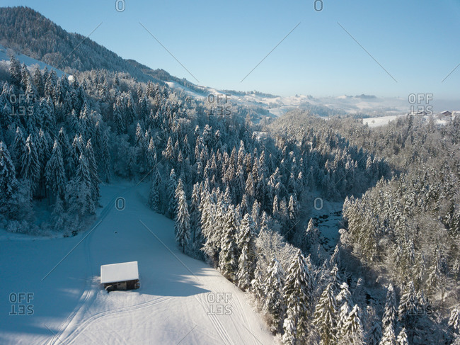 Aerial View of Snow Covered Trees and Hut in Schwyz, Switzerland