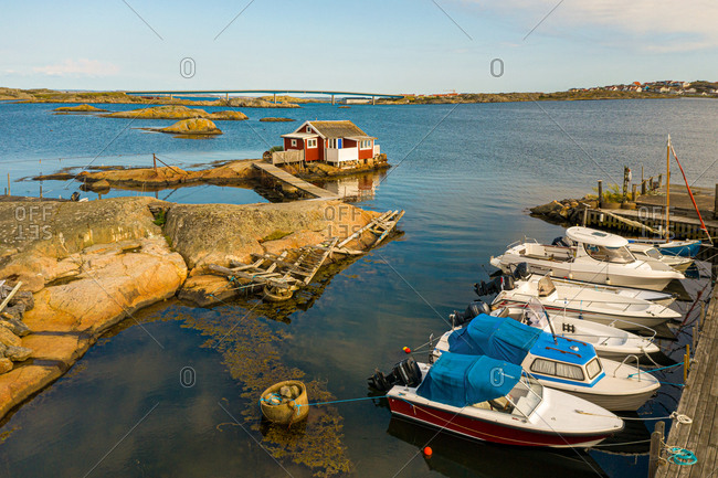Aerial view of a cottage and anchored boats, Gothenburg archipelago, Sweden.