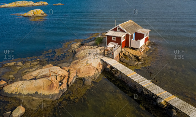 Aerial view of a red cottage , , Gothenburg archipelago, Sweden.