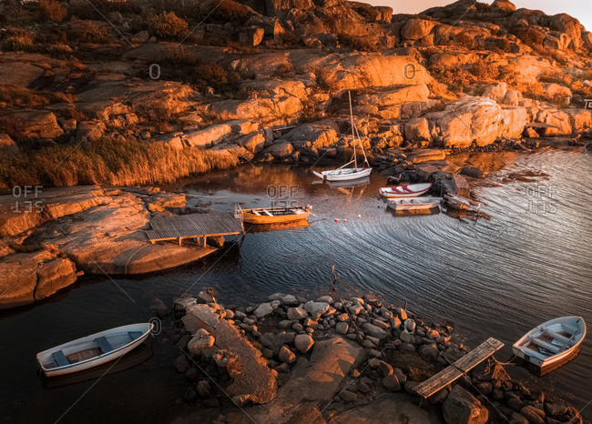 Aerial sunset view of a small rocky bay with anchord boats in , Gothenburg Archipelago, Sweden.