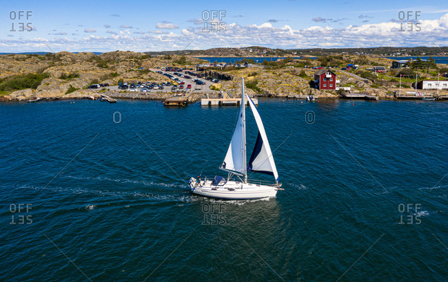 Aerial view of sailing boats cruising at the coast of  island, Kattegat, Gothenburg archipelago, Sweden.