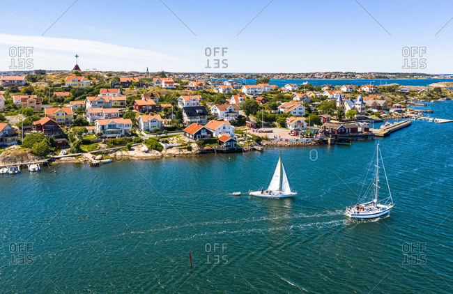 Aerial view of sailing boats cruising at the coast of Kalvsund island, Kattegat, Gothenburg archipelago, Sweden.