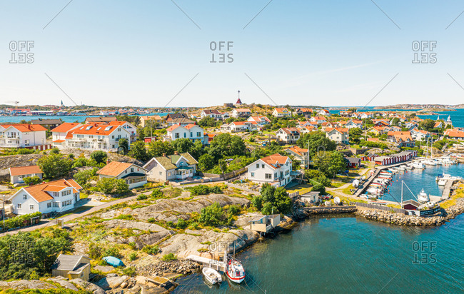 Aerial view of Klavsund island with boats anchored in the harbor  and watch tower  Gothenburg archipelago, Kattegat, Sweden.