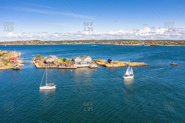 panoramic Aerial view of sailing boats cruising at the coast of  island, Kattegat, Gothenburg archipelago, Sweden.
