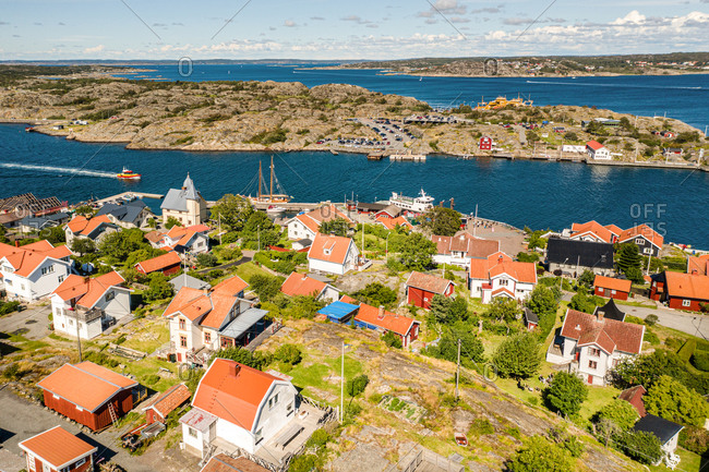Panoramic aerial view of Kalvsund and island with boats and flags, Gothenburg archipelago, Sweden.
