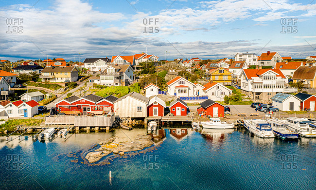 panoramic view of  island, with typical red boat houses and boats anchored,  Gothenburg archipelago, Sweden.