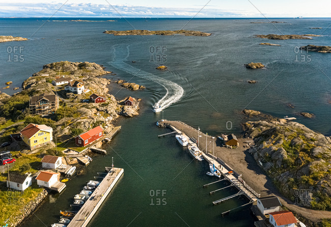 Aerial view of  harbor area with anchored boats and  houses, Gothenburg Archipelago, Sweden.