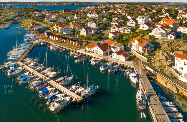 Aerial view of  harbor area with anchored boats and red boat houses, Gothenburg Archipelago, Sweden.