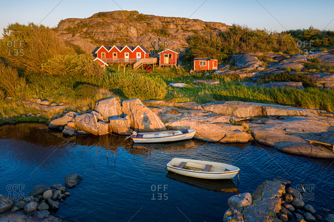 Aerial view of a small bay with red boat houses and boats in, Gothenburg Archipelago, Sweden, Scandinavia