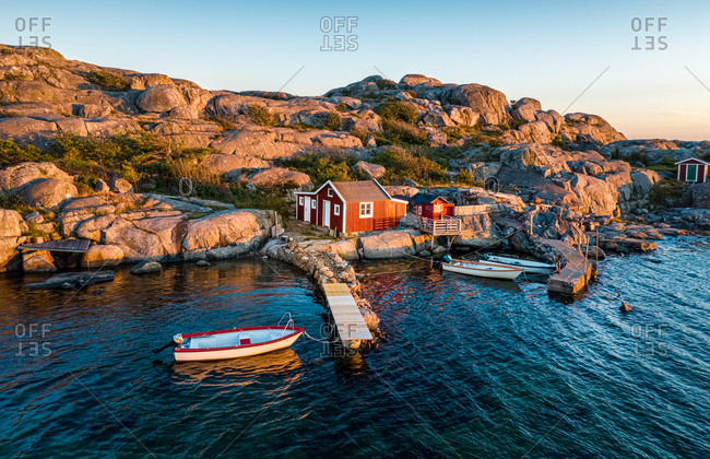 Aerial view of a small bay with red boat houses and boats, Gothenburg Archipelago, Sweden, Scandinavia