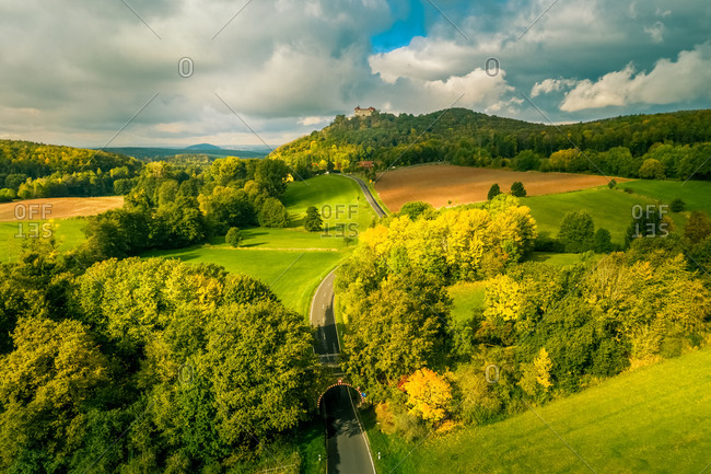 Aerial view of a rural landscape with a castle on the hill in autumn,  Hessia, Germany.